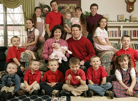 Americans Jim Bob and Michelle Duggar, of Arkansas, with their 19 children. Michelle was pregnant with their 20th at the time this photo was taken.
