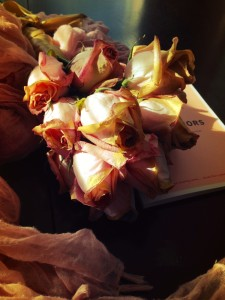 dried roses, book, and scarf