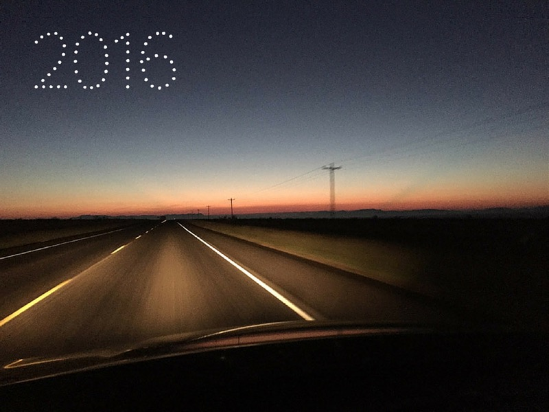 empty road leading into sunset with 2016 written in the sky